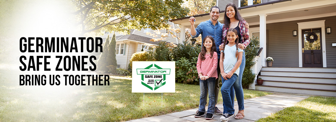 Family Posing Outside Home Next to Safe Zone Yard Sign Symbolizing That Germinator Bring People Together