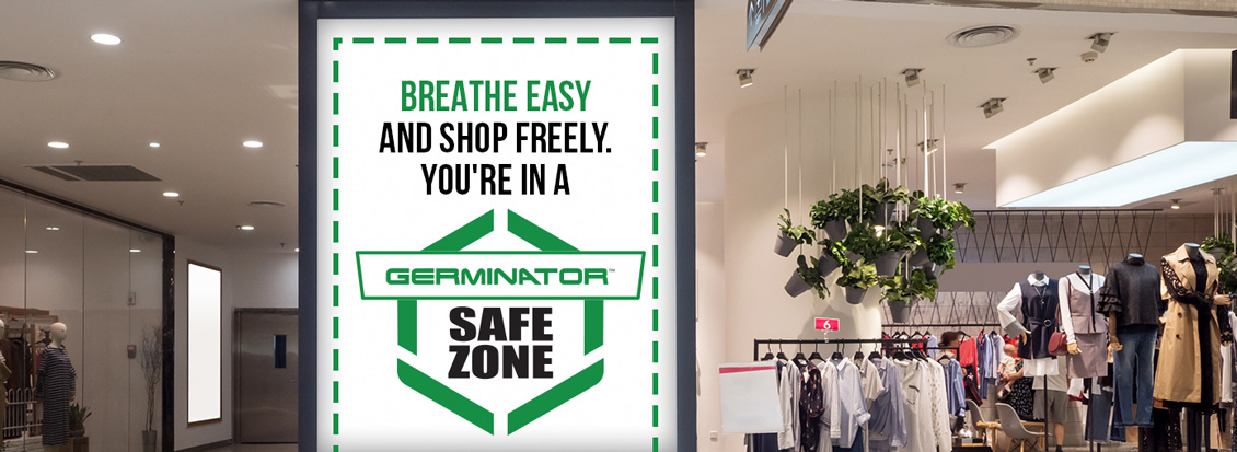 Clothing Section in Mall With Safe Zone Sign Reassuring Shoppers to Breathe Easy and Shop Freely